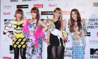 2NE1 poses for photographs on the red carpet of the MTV Video Music Awards Japan 2012 at Makuhari Messe on June 23, 2012 in Chiba, Japan