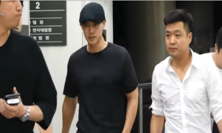 Kim Hyun Joong leaving court after a hearing in July.