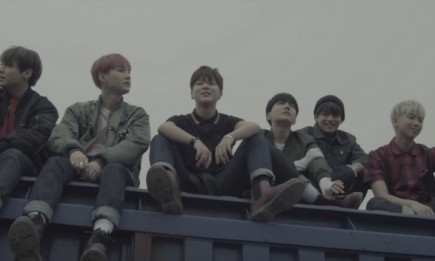"BTS in the official music video of ""I NEED U."""